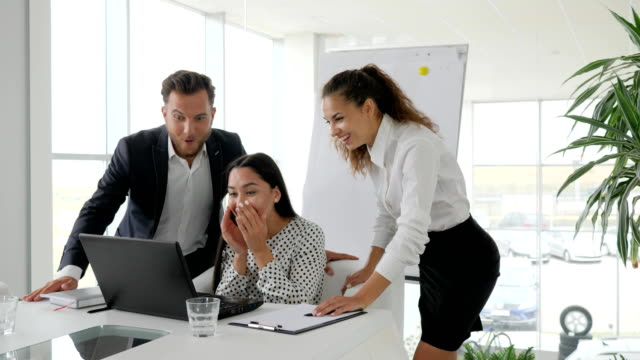 happy-managers-jump-young-successful-people-successful-deal-business-team-in-modern-office-emotional-employees