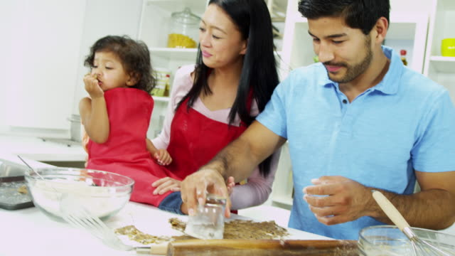 Asian-Chinese-couple-baking-organic-cookies-home-kitchen