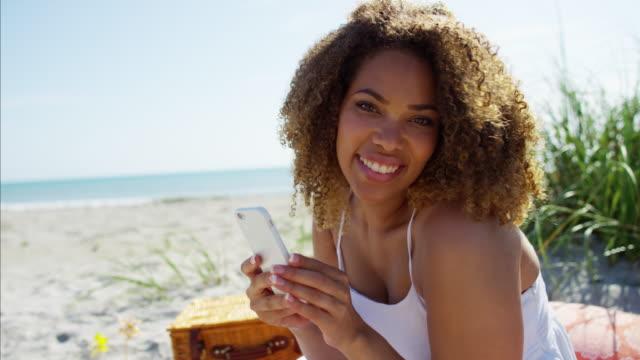 Plus-size-Ethnic-female-picnic-in-sand-dunes