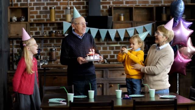 Grandparents-singing-happy-birthday-to-grandson