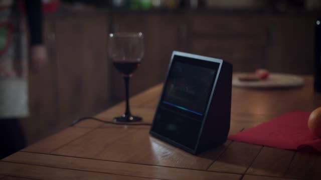 4k-Woman-Controlling-Lights-with-Smart-Home-Device