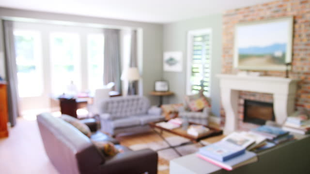 Furnished-sitting-room-in-a-family-home-rack-focus-shot