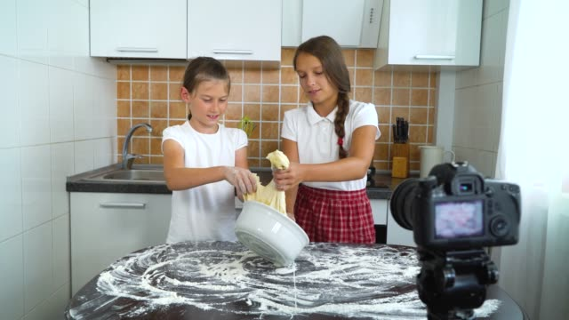 Young-vloggers-recording-video-content-for-food-blog-preparing-for-dough-kneading