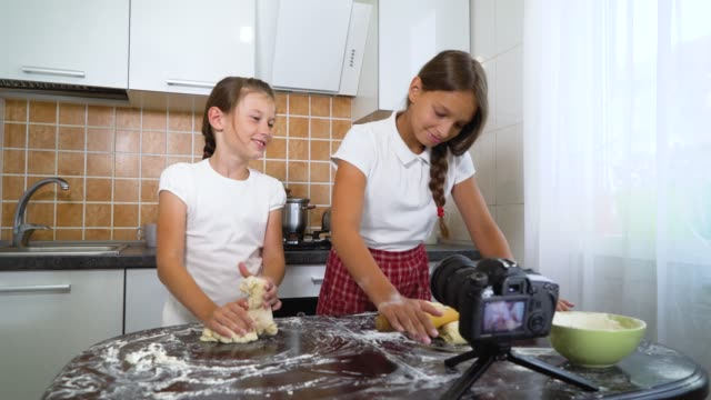Young-vloggers-recording-video-content-for-food-blog-rolling-dough-with-rolling-pin