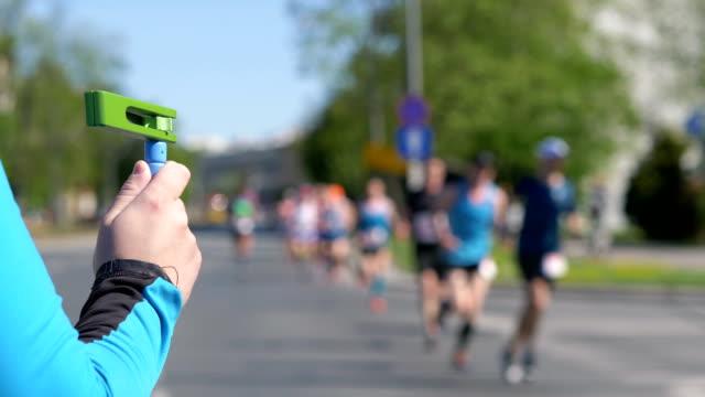 Man-cheering-runners-in-4k-slow-motion-60fps