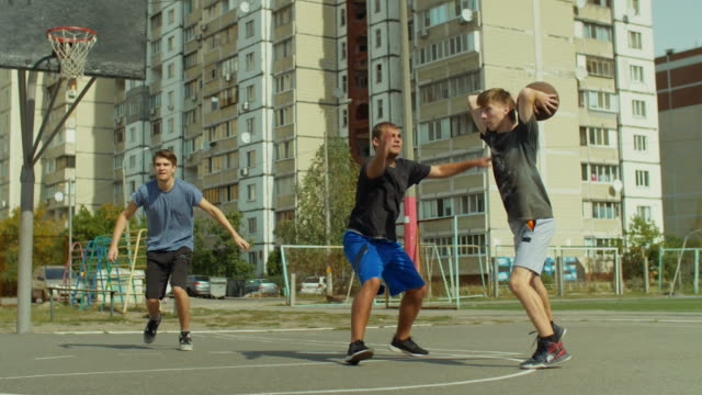 Streetball-player-blocking-shot-on-basketball-court