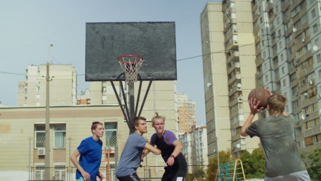 Streetball-players-figthing-for-rebound-on-court