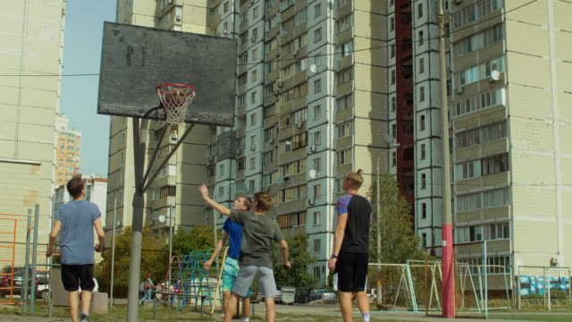 Teenage-streetball-players-in-action-outdoors