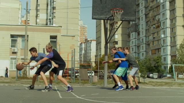 Basketball-player-taking-jump-shot-on-court