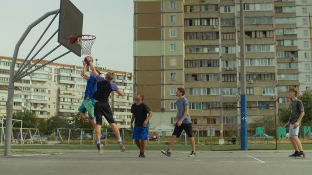 Handsome-streetball-player-doing-reverse-layup