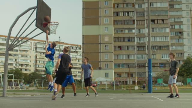 Streetball-team-scoring-points-after-layup-shot