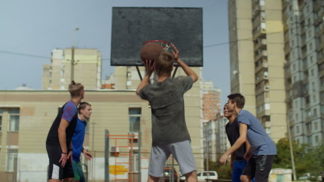 Streetball-player-taking-a-free-throw-on-court