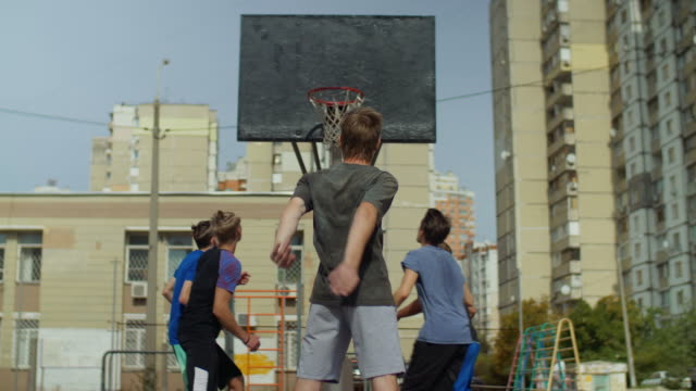 Streetball-teenager-missing-a-free-throw-outdoors