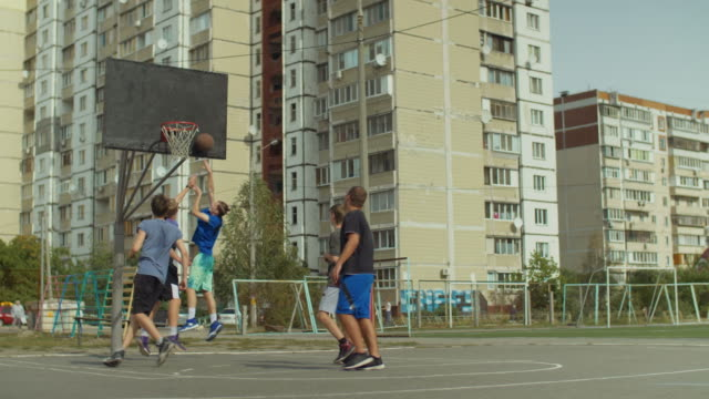 Streetball-player-making-successful-assist-on-court