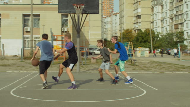 Streetball-players-in-action-on-basketball-court