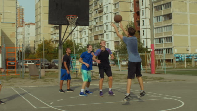 Basketball-player-shooting-for-field-goal-on-court