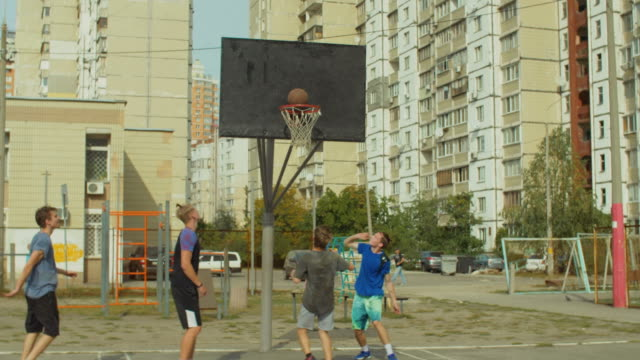 Streetball-player-scoring-field-goal-with-layup-shot