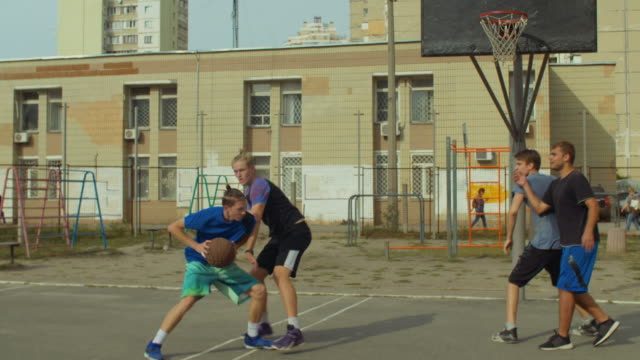 Basketball-player-scoring-field-goal-with-jump-shot