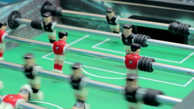 Macro-ver-fútbol-de-mesa-jugar-juego-de-mesa-entretenimiento