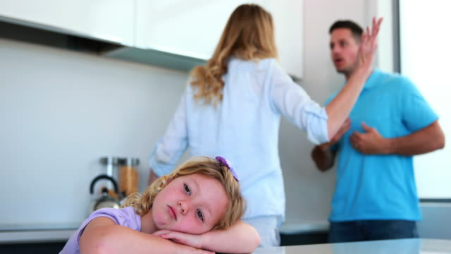 Parents-arguing-behind-their-sad-daughter