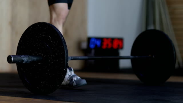 Man-Prepares-To-Lift-Heavy-Barbell-Doing-Exercise-During-Workout-Training-At-Gym-Weightlifting