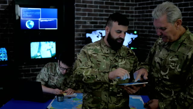 discussing-battle-strategy-and-looking-at-digital-tablet-security