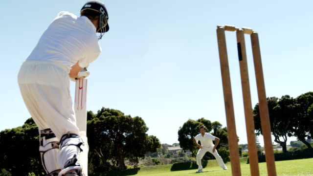 Batsman-playing-a-defensive-stroke-during-cricket-match