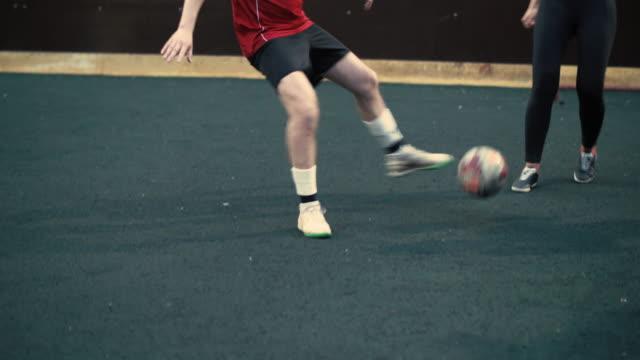 Training-woman-football-team-Women-play-football-Female-football-match-The-girl-is-falling-the-woman-failed