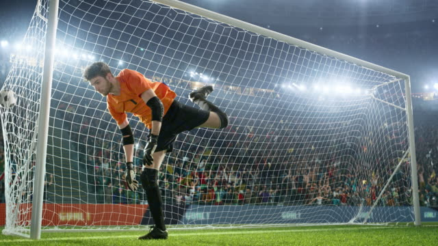 Soccer-goalkeeper-jumps-and-fails-to-catch-ball