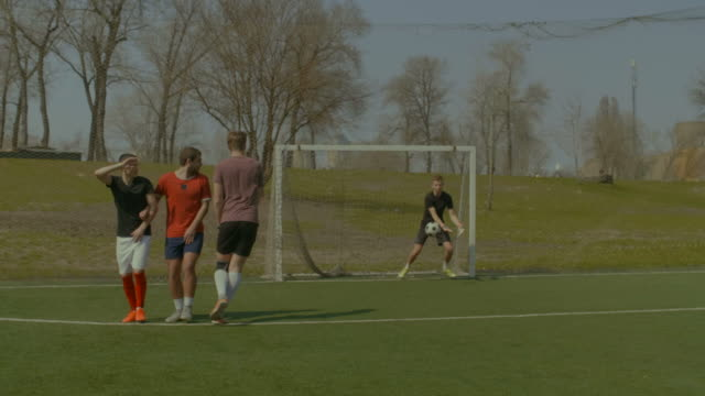 Soccer-player-taking-direct-free-kick-during-game