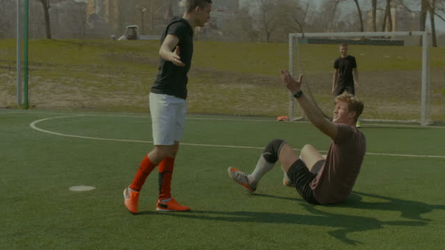 Defender-committing-a-foul-during-football-match