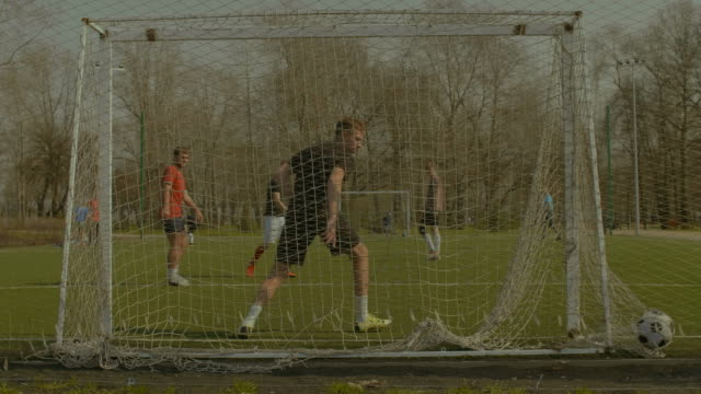 Striker-scoring-a-goal-during-training-match