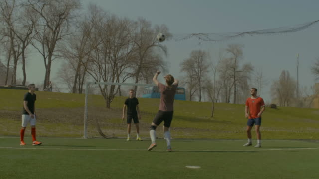 Soccer-players-practicing-football-on-the-pitch