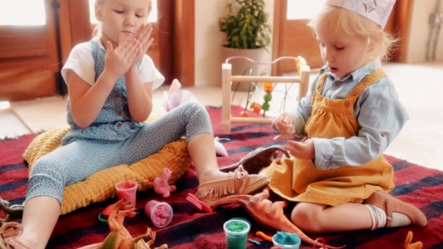 Little-girls-having-fun-playing-with-play-dough-at-home