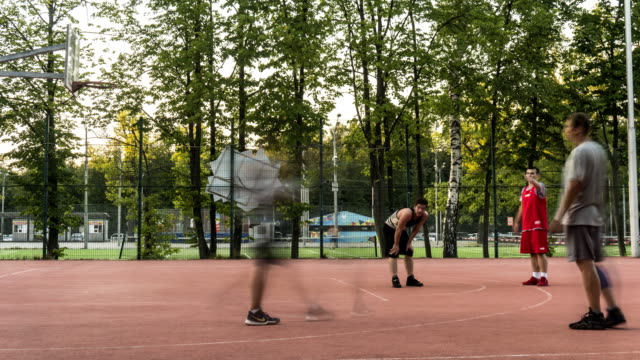 young-people-enthusiastically-play-street-basketball-from-morning-to-evening-time-lapse