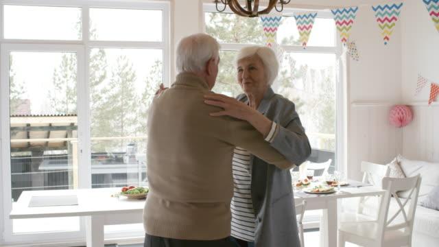 Joyous-Senior-Man-and-Woman-Dancing-at-Party