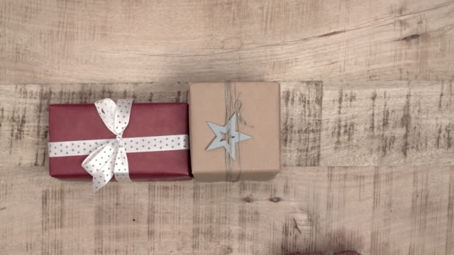 Stack-of-christmas-presents-on-wooden-background