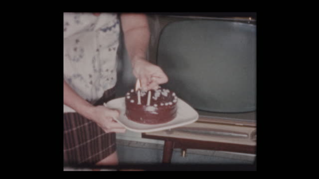 1961-2-year-old-boy-blows-out-candles-on-Birthday-cake