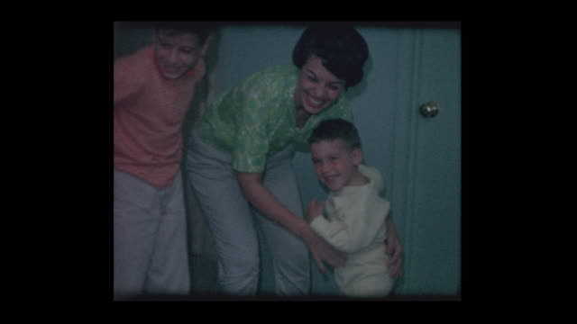 1963-Mother-surprises-young-son-with-new-sandbox