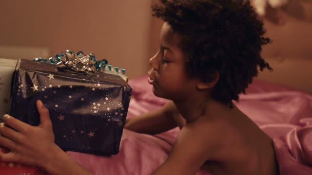 Child-hugs-gift-boxes-