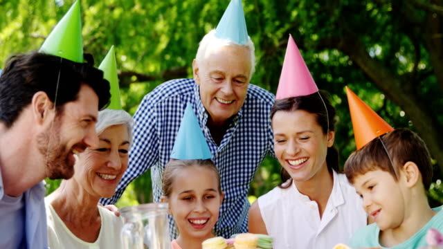 Multi-generation-family-celebrating-birthday-party