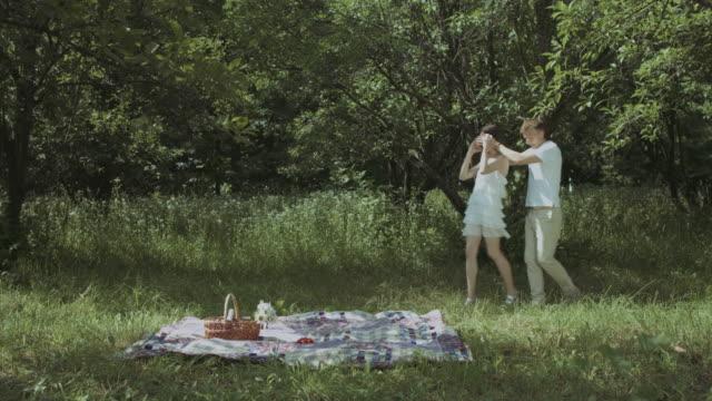 Loving-man-making-romantic-surprise-to-his-woman
