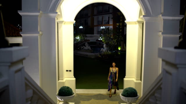 Evening-city-A-woman-passes-through-the-arch-and-ascends-the-stairs