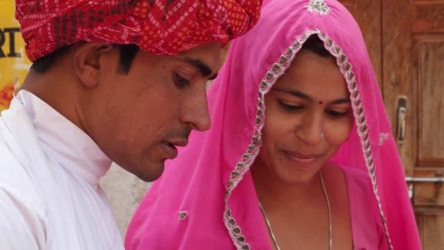 Good-looking-couple-shopping-happy-together-sharing-love-life-in-Rajasthan-India-newly-wed-pink-red