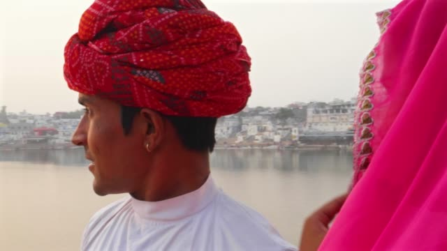 Rajasthani-couple-watching-the-sun-setting-at-the-Pushkar-Lake
