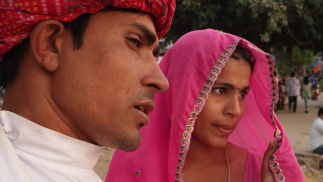 Close-up-of-Beautiful-woman-in-pink-saree-and-handsome-guy-in-turban-in-India