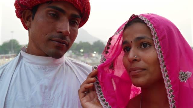 Pan-to-closeup-beautiful-Indian-bride-and-handsome-husband-in-Pushkar-India
