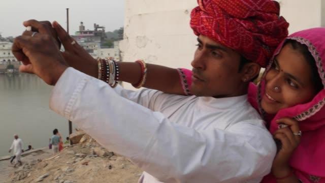 Indian-couple-taking-beautiful-sunset-camera-phone-photos-Pushkar-Lake-Rajasthan