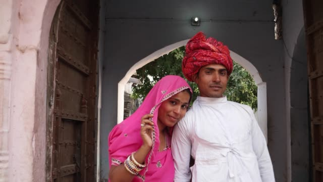 Loving-Indian-couple-standing-in-front-of-old-heritage-architectural-entry-archway-in-Rajasthan-India