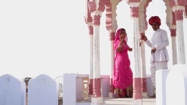 Indian-couple-in-traditional-dress-under-a-traditional-Rajasthani-Chattri-or-canopy